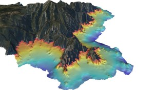 Figure 4: Modèle Numérique de Terrain d'une bathymétrie fine (pixel de 2 m) pour la cartographie des récifs coralligènes. (en gris la zone terrestre, en rouge la zone -10 m et en bleu foncé la zone à -60 m) © Andromède océanologie